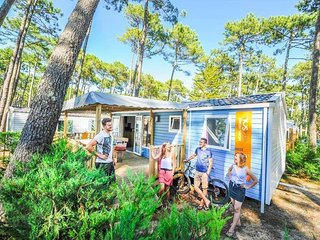 Cozy mobile home with a covered terrace 100 m from the beach