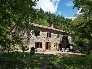 Beautiful stone farmhouse in mountain forest setting