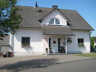 House with modern interior and garden in the Volcanic Eifel near deer and game p