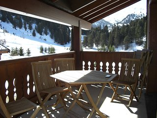 Charming apartment a short distance from the slopes and the Lac Tueda