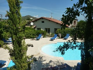 3 cottages around a swimming pool in a small village.