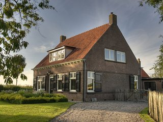 Spacious Farmhouse in IJzendijke with Garden