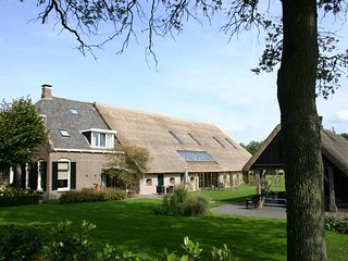 Nostalgic farmhouse with covered terrace near the Dwingelderveld National Park.