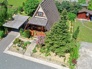 Idyllically situated A-frame house in the Sauerland with garden and covered terr