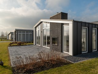 Modern chalet with a fireplace near the Oosterschelde