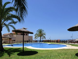 Modern apartment with beautiful roof terrace and only 750 m from the sandy beach