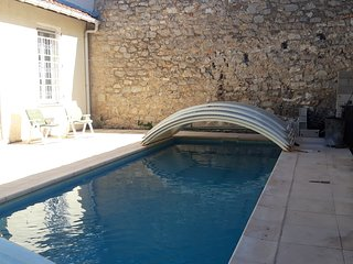 4 bedroom house in mediterranean town centre with sunny garden and private pool