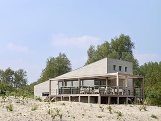 Luxury villa with washing machine located in nature reserve