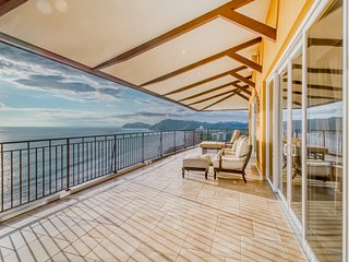 Top-floor, luxury oceanfront condo w/stunning views & shared pool near the beach