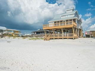 New listing! Gulf front home only steps to the water's edge.