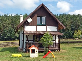 The holiday house is located near the forest, 300 m from the lake, 6 km from sea