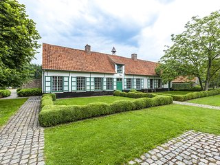 beautifull renovated farmhouse with traditional elements and a big garden