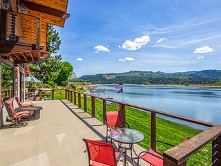 Custom-built riverfront home w/ private dock, game room, hot tub, heated floors!