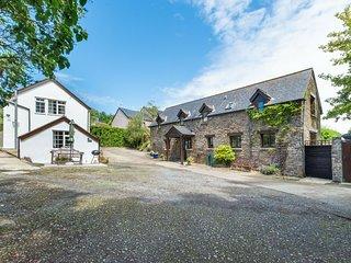 Characteristic stone farmhouse in hilly Devon, near the sea