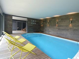 Chic and trendy house with indoor pool, movie theater room, 9 bed- and bathrooms