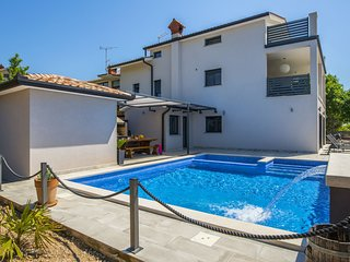 Villa with swimming pool, outdoor kitchen, sauna, jacuzzi, play area and sea vie