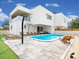 Modern villa near Vodice, with a private swimming pool and the beach just 100 me