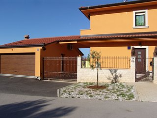 Comfortable apartment with fenced garden and outdoor terrace and grill, airco