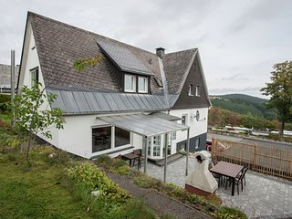 Holiday home in a quiet location directly above the 'Postwiese' skiing area in N