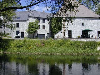 Charming accommodation with garden located along the river The Viroin.