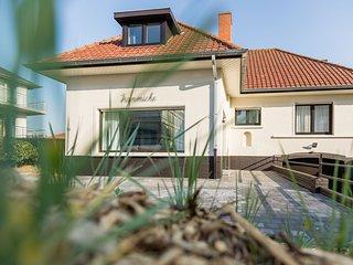 Spacious Holiday Home with Sauna in Koksijde