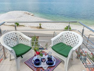 Apartment with a balcony with sea view, and the beach just outside the door