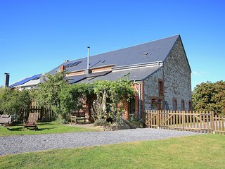 Ecologically renovated former farmhouse in the middle of a adorned village.