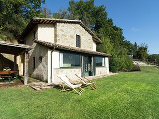 Rustic house with private garden and community swimming pool