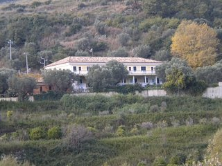 A country estate with pool surrounded by olive trees and near the sea.