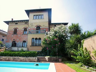 Elegant Art Nouveau villa with private pool a short distance from the lake.
