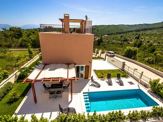 New villa with a private pool and sea view top terrace