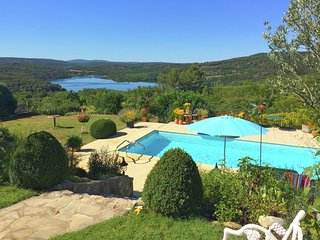 Attractive holiday home with private swimming pool and vast views across Lac du