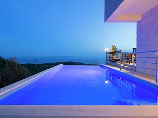 Stunning views hill side villa with infinity pool & indoor floor aquarium