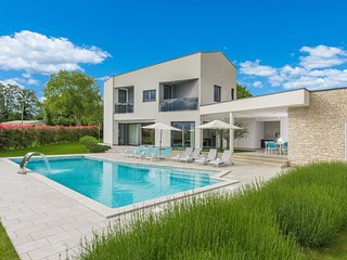 A modern luxury villa with a crystal-clear swimming pool and cultivated garden