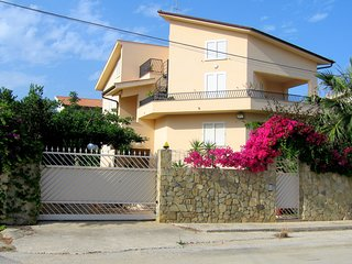 A sun-drenched holiday apartment just a few metres from the Sicilian coastline