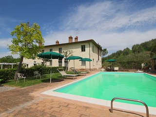 This beautiful farmhouse with pool and views over vineyards and olive groves