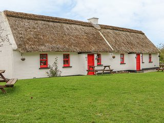 NO. 10 TIPPERARY THATCHED COTTAGE, semi-detached, garden with private seating
