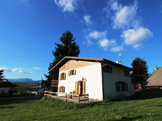 A detached alpine villa in Asiago, with a large garden and easy slope access.