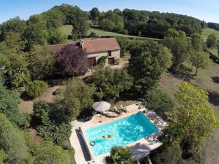 Holiday home with AC and private pool in forested surroundings.