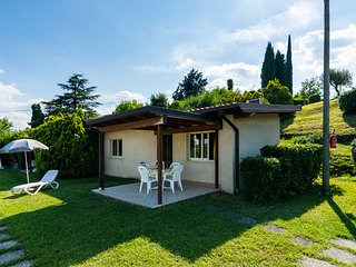 Apartment on Lake Garda with pebble beach, pier for boat, three swimming pools