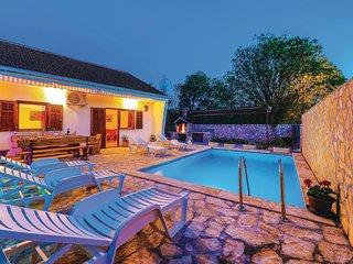 Beautiful home in Primorski Dolac w/ WiFi and 2 Bedrooms (CDF951)