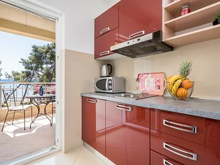 Modern & freshly decorated apartment with a balcony,  just steps from the beach