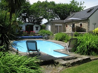 Detached house with a well-maintained enclosed garden with a private swimming po