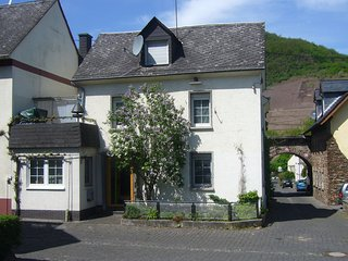 House with balcony in a romantic village between the Mosel and the vineyards