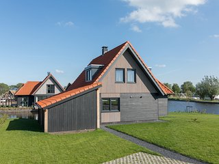 Modern watervilla with three bathrooms, at the Frisian Lakes
