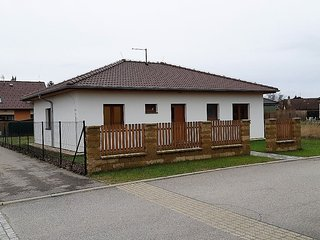 Detached bungalow with washing machine in the fenced garden in southern Bohemia