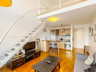 Two-story loft w/furnished balcony and wonderful city views!