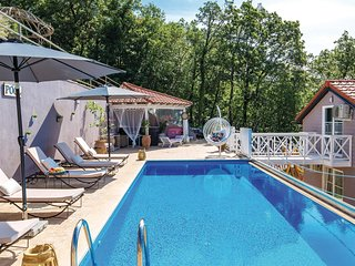 Nice home in Veprinac w/ Outdoor swimming pool, Outdoor swimming pool and 4 Bedr