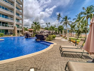 Breezy oceanfront condo w/shared pool & great views. Just steps from the beach!