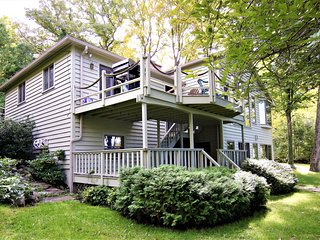 Lovely, updated home with panoramic lake views, dock & boat lift!
